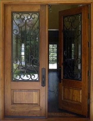 Puerta de calle doble un tablero y reja puertas alberto cano for Puertas antiguas de madera de 2 hojas